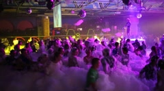 Stock Video Footage of Youth having fun and dancing in nightclub during foam party