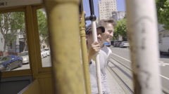 Gay Couple Hold On And Stand During Trolley Ride Through San Francisco(4K) Stock Footage