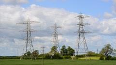 Time lapse giant electricity pylons near Leeds United Kingdom Stock Footage