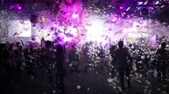 Foam falls on people dancing at a party in Tuning hall nightclub - stock footage