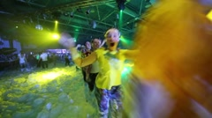 The chain of people running in the foam during a party Stock Footage