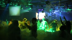 Stock Video Footage of Youth dancing in the foam in Tuning hall nightclub