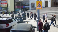 People walk near the monument to Yuri Nikulin. Stock Footage