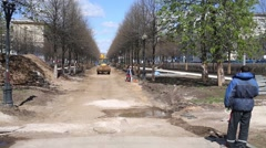 Bulldozer and construction workers in park on Tsvetnoy Boulevard Stock Footage