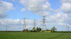 Time lapse high tension power lines in countryside leeds yorkshire uk Stock Footage