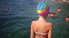 Little girl is putting on her goggles to the water. Stock Footage