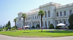 Tourists visiting the Livadia Palace with green lawn. Stock Footage