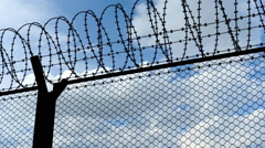 Fence with a barbed wire, animation Stock Footage