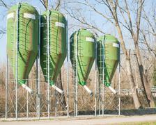 farm silos for fish farming - stock photo