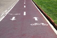 Bike lane with symbols Stock Photos