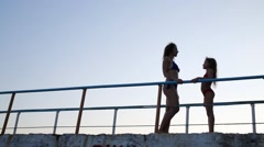 Stock Video Footage of Mother and daughter silhouette are talking in swimsuit standing