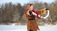 Woman dances holding stretched garland of artificial snowballs Stock Footage