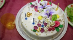Birthday cake decorated with cream and caramel flowers. Stock Footage