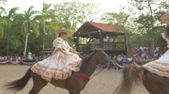 Mexican women riding horses at a gathering in Cancun Stock Footage