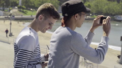 Gay Couple Hanging Out At The Beach, Drawing On A Tablet And Taking Photos(4K) Stock Footage