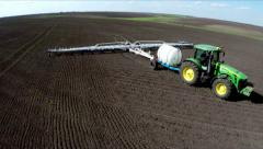 Tractor cultivating the soil using the harrows.Aerial footage. Bird's-eye view Stock Footage
