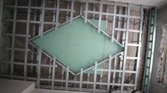ceiling made of gypsum plasterboard in room under repair. - stock footage