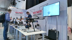 Exhibition of drones  technologies in  business hall .4K 3840x 2160 Stock Footage