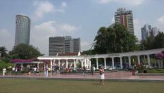 Pan as tourists visit Independence Square, Kuala Lumpur, Malaysia Stock Footage