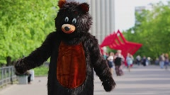 Actor dressed in bear costume stands and admires good weather. Stock Footage