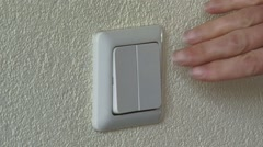 Double Wall Light switch - turn on the light Stock Footage