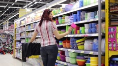 Female Chooses Plastic Utensils for the Kitchen Stock Footage