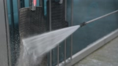 A man washing the Car Mats at the car wash self-service using water washes foa - stock footage