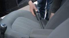 man vacuuming your car at the car wash self-service salon - stock footage