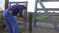 Cowboy Rancher, opening the gate - stock footage