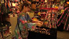 Woman stall holder arranges necklaces for sale, Central Market, Kuala Lumpur, - stock footage