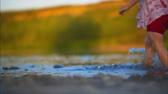 Kids are Running  in the River - stock footage