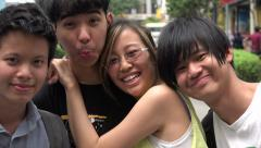Young Malaysian adults smile for the camera, Kuala Lumpur, Malaysia Stock Footage