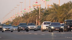 Stock Video Footage of Traffic drives over a highway in Abu Dhabi during rush hour