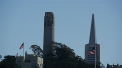 Coit Tower and the The Transamerica Pyramid with American Flags Stock Footage