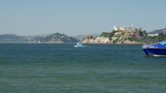 Ferry passing by with Alcatraz Island at the background Stock Footage