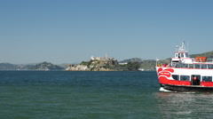 Ferry passing by with Alcatraz Island at the background - stock footage