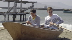 Tourists Pretend To Row An Old Boat At Fisherman's Wharf, Take A Selfie Stock Footage