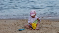 Little Girl Playing Bucket And Shovel Dig On Sand Beach Sea Stock Footage