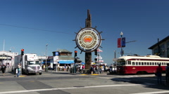 Tram passing by the Fisherman's Wharf sign in San Francisco Stock Footage