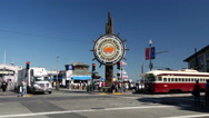 Stock Video Footage of Tram passing by the Fisherman's Wharf sign in San Francisco