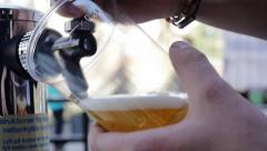 Beer glass fills up outside bar 1023 Stock Footage