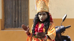 Indian sadhu in mythological clothing blesses the people on the street. Pushkar - stock footage
