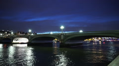 Westminster Bridge over River Thames by night - stock footage