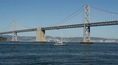 Sailboat at the Oakland Bay Bridge in San Francisco Stock Footage