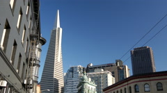 Tilt from the Transamerica Pyramid and the Columbus Tower to the street Stock Footage
