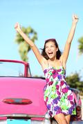 Summer vacation car road trip freedom - happy woman driver driving car Stock Photos