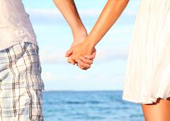 Holding hands couple - Romantic love and happiness concept image Stock Photos