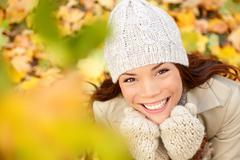 Autumn woman in yellow leaves portrait - Asian fall girl - stock photo
