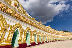 Facade of the U-Min Thonze (thirty caves) pagoda in Sagaing hills, Myanmar - stock photo