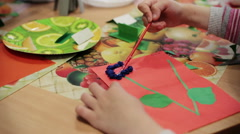 child makes application flower - stock footage